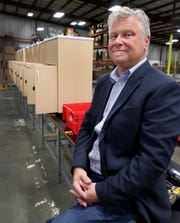 Martin Watts, the CEO of Ozark River Portable Sinks, sits next to a line of some of his sinks in his Murfreesboro plant on Wednesday April 22, 2020.