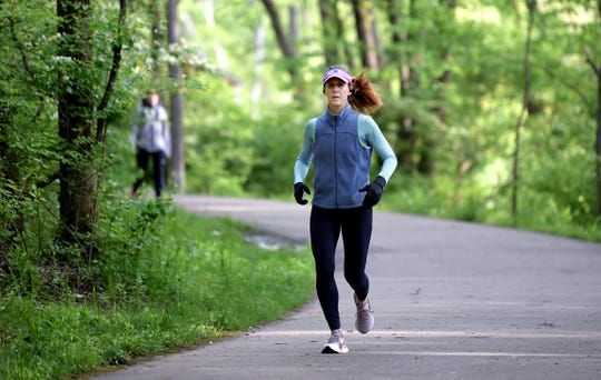 Rabbi Laurie Rice runs at Percy Warner Park in Nashville on Wednesday, April 22, 2020.