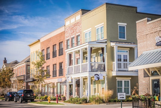 Regent Homes' live-work townhomes in Berry Farms have commercial space on the first floor and two levels of living space above.