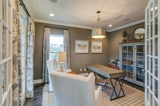 French doors set off this home office in a house built by Patterson Company.