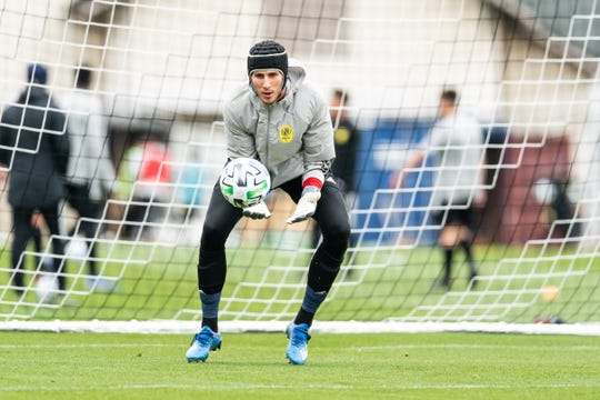 Nashville SC reserve goalkeeper Elliot Panicco controls an incoming shot during a training session at Currey Ingram Academy.