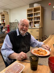 Amato about to dig in to ravioli that he made at a cooking class to celebrate his 90th birthday at Healthy Italia in Madison in February 2019.
