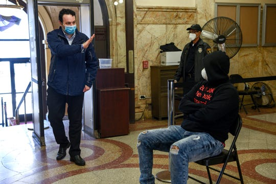 Paterson Mayor Andre Sayegh enters City Hall for the first time since recovering from Covid-19, Sayegh quarantined in his Paterson home for two weeks and tested negative for the coronavirus prior to returning to work on April 22, 2020.