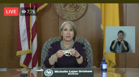 New Mexico Gov. Michelle Lujan Grisham opens a livestreamed news conference from the state Capitol in Santa Fe on Wednesday, April 22, 2020.
