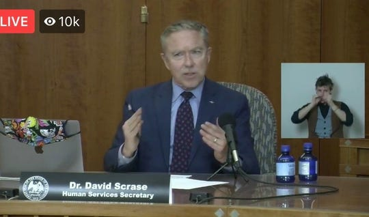 New Mexico Human Services Secretary David Scrase speaks during a livestreamed news conference from the state Capitol in Santa Fe on Wednesday, April 22, 2020.