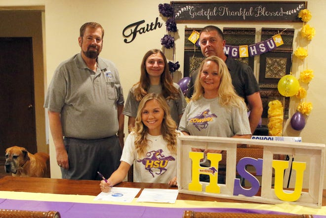 Alexa Sowers signs her letter of intent to attend Hardin-Simmons University in Abilene, Texas on April 21, 2020. Sowers plans to play volleyball and run the 100m hurdles while attending college.