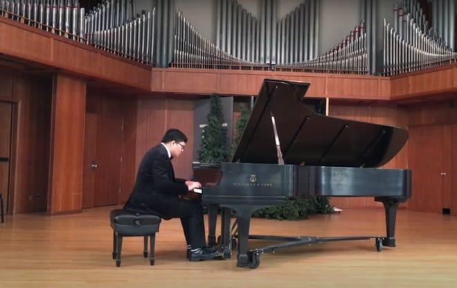 Senior winner Matthew Gurning concentrates on Beethoven's sonata op. 109 3rd mov. (Andante molto cantabile ed espressivo).