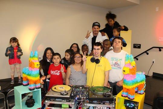 DJ Alf Alpha treats UCPIE kids to a fun dance party.