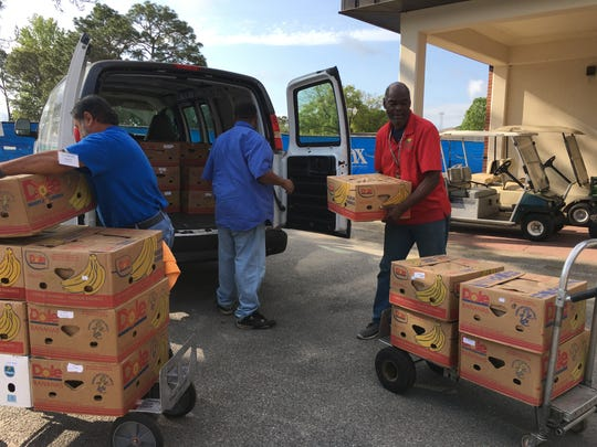 Manna Food Pantries donated 33 banana cases filled with food staples to Pensacola State College on Tuesday, April 7, in response to a survey of students needs during the COVID-19 pandemic.