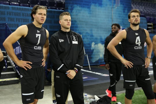 Bob McManaman projects three quarterbacks to be drafted in the top 10 of the NFL draft, including Oregon's Justin Herbert (7) and LSU's Joe Burrow (2), shown here on the sidelines during the 2020 NFL Combine at Lucas Oil Stadium.