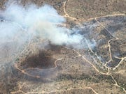 The Whitlow Fire burned in the area near Hewitt Station Road north of Highway 60 west of Superior on April 21, 2020.