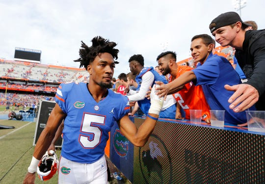 Nov 10, 2018; Gainesville, FL, USA; Florida Gators defensive back CJ Henderson (5) high fives fans as they beat the South Carolina Gamecocks at Ben Hill Griffin Stadium. Mandatory Credit: Kim Klement-USA TODAY Sports