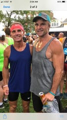 Rob Bare, left, and his older brother Mike enjoy a moment together after a race.