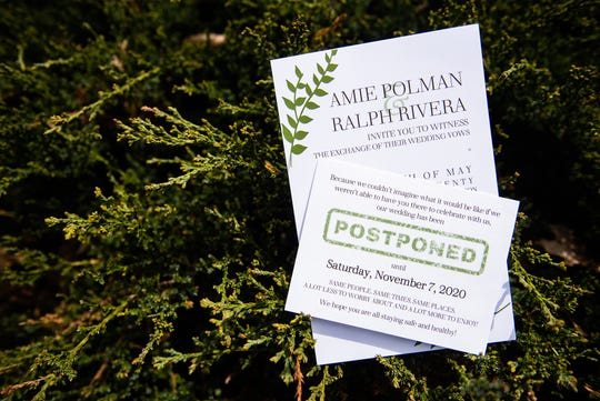 The Wedding invitation and postponement card for Amie Polman and Ralph Rivera's wedding in Chester on April 17. Their wedding, which was originally supposed to be held on May 16, has been postponed to Nov. 7, due to COVID-19.