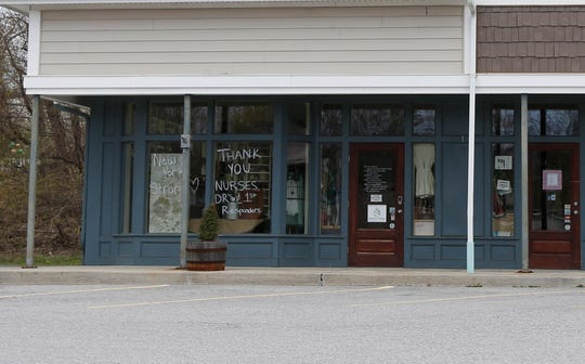 Though Simplicity consignment shop in Wappingers Falls is closed, its windows include supportive messages for first responders and residents.