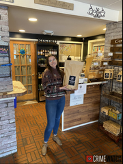 Jason Wehrle and Holly Lanteigne-Marrow of Belmont Bean Company, located on South Belmont in Spring Garden Township, donated 5 pounds of coffee to the Spring Garden Township Police Department. Pictured is Belmont's Tori Smith.