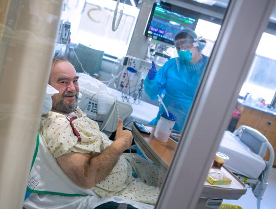 "COVID-19 patient Wayne ""Huffy"" Hoffman from Lebanon and Katlyn Ecklund, a registered nurse in the COVID-19 unit at Penn State Health Milton S. Hershey Medical Center, give a thumbs up as they pose for a photo."