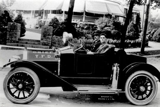 York City Councilman Felix Bentzel, right, and York City Fire Chief Harry Wills sit in a 1914 York-made Pullman chief's car. Thomas Shipley, who built the home in the background, is standing on the porch. This was the first vehicle for the York Fire Department, now York City Fire/Rescue Services. Bentzel was commissioned with modernizing the department.