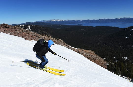 A skier takes advantage of perfect corn snow during a backcountry ski tour up Ward Canyon guided by Alpenglow Sports in the Sierra Nevada mountains near Tahoe City on Feb. 21, 2015.