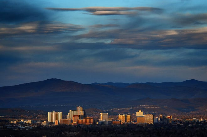 Downtown Reno is seen illuminated by the setting sun on March 19, 2016.