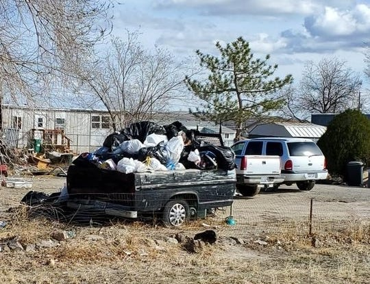 Trash piles up in a trailer at a Silver Springs residence.