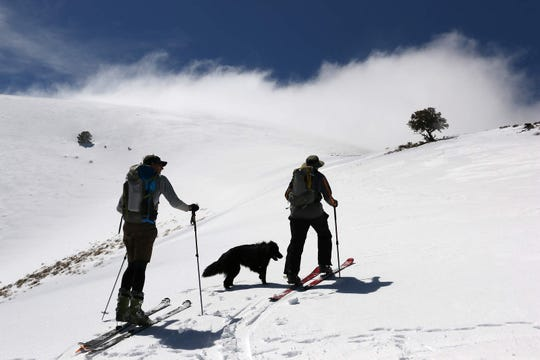 Rick Gunn, left, and Daniel Ellsworth skin up towards the Toiyabe Crest while skiing in the Toiyabe Range in central Nevada on April 1, 2017.