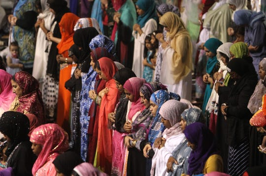 Muslims pray at the Henrietta Dome Arena during an Eid al-Fitr service at the end of Ramadan 2014. The annual gathering will likely be canceled in 2020 due to the coronavirus pandemic.