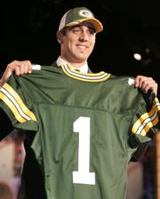 Aaron Rodgers holds up a Green Bay Packers jersey after being picked 24th overall in the first round of the 2005 NFL Draft in New York. The Bills gave up their 2005 first-round pick to trade back into the first round for J.P. Losman the year before and Rodgers was still on the board when Dallas selected Marcus Spears with the pick.