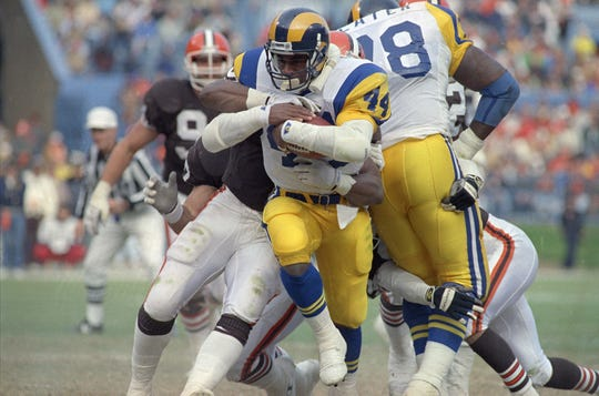 Los Angeles Rams running back Gaston Green romps for nine yards during the second quarter of Sunday's 38-23 win over the Cleveland Browns, December 3, 1990, in Cleveland, Ohio. The Rams selected Green 14th overall in the 1988 draft, a pick obtained from Buffalo in the Cornelius Bennett trade.