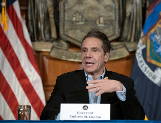 In this April 18, 2020 photo provided by the Office of Governor Andrew M. Cuomo, Gov. Cuomo provides a coronavirus update during a press conference in the Red Room at the State Capitol in Albany.