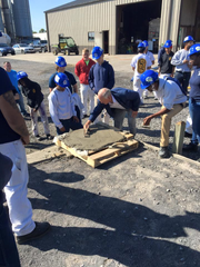 Floyd Rayburn, who owns a masonry company in Canandaigua, showed students last fall how to pour concrete. He wants to reopen his business after being shuttered due to the coronavirus.