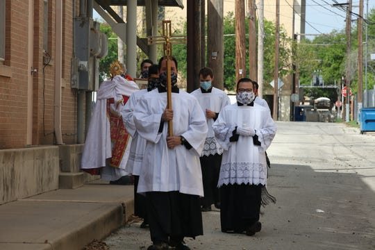 Seminarians of the Roman Catholic Diocese of San Angelo joined by Vocation Director Fr. Michael Rodriguez processed around the Cathedral of the Sacred Heart in downtown on Sunday, April 19, 2020, in advance of blessing local medical centers and assisted-living facilities as America joins the world in combating the first pandemic in more than 100 years.