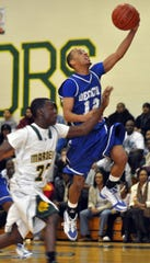 Stephen Decatur's Cedrick Johnson goes up for a shot over Mardela's AJ Henry during the first half of their game on Thursday night in Mardela Springs. (Matthew S. Gunby Photo)
