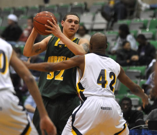 Mardela's Kody Jacoby looks for a player to pass to while being guarded by Pocomoke's Khalie Dickerson  during the first half of their game on Thursday night at Wicomico Youth and Civic Center in Salisbury. (Matthew S. Gunby Photo)
