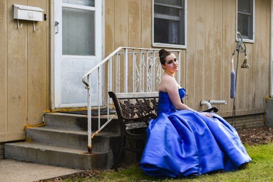 Lincoln High School senior Morgan Oskar wears her prom dress in her front yard on Saturday, April 18, in Sioux Falls. Her choice of dress was inspired by the renaissance fair she attended every year since she was a month old.