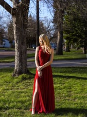 Roosevelt High School senior Alyssa Eichmann wears her prom dress in her front yard.