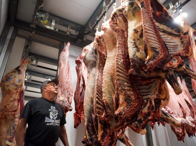 Mike Eggers poses for a portrait in the meat locker on Wednesday, April 22, 2020 at Renner Corner on in Renner, S.D. The corner store has seen an increase in customers due to the impact the coronavirus has had on the meatpacking industry.