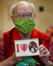 Charlie Cox holds a picture of his late wife Evelyn on Wednesday, April 22, 2020.