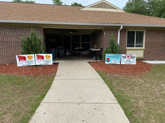 Relatives of residents at Tallahassee Developmental Center put signs of support in front of the intermediate care facility for people with developmental disabilities.