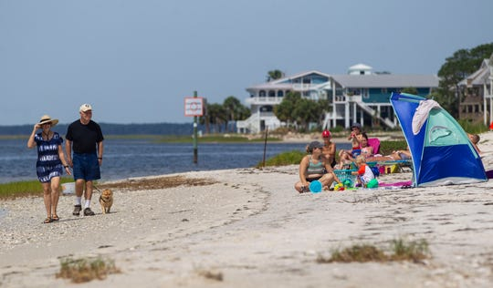 Families and friends flock to Shell Point Beach Wednesday, April 22, 2020.  Wakulla County Commissioners Monday unanimously approved reopening its beaches.