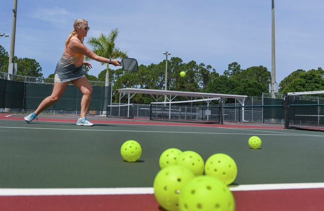 Sheri Tower, of Stuart, returns a volley to her husband Randy while on the pickleball courts with their friend Dennis Mackey at Halpatiokee Regional Park on Wednesday, April 22, 2020, in Martin County.