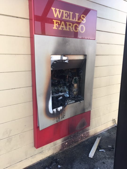 The ATM at Wells Fargo on South Mooney Boulevard was significantly damaged after an arsonist set fire to the bank Wednesday morning.