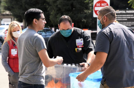 Kaweah Delta Medical Center staff receive donated 3-D-printed masks on Tuesday, April 21, 2020. The first batch of about 150 masks came from the efforts of College of the Sequoias, ProYouth, Visalia Unified School District and Exeter Unified School District.