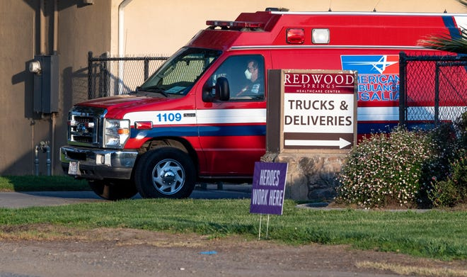 An ambulance leaves Redwood Springs on Tuesday, April 21, 2020. there have been 15 COVID19 related deaths at the facility and 172 cases. Redwood Springs has nine CAL-MAT members at its facility: five EMTs, two nurses, a director and a logistics chief, according to Tim Lutz, Tulare County HHSA director.