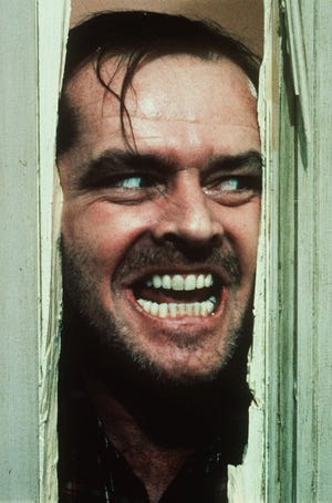 """Jack Nicholson stars as increasingly deranged author Jack Torrance in the classic 1980 Stanley Kubrick film """"The Shining."""" After breaking in the door with an ax to face his horrified wife, Jack proclaims, """"Heeere's Johnny!"""""""