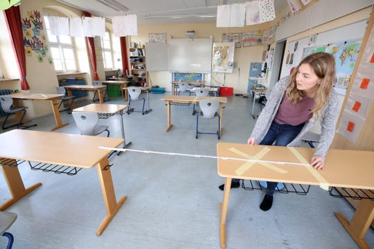 Staff tape off social-distancing markings during preparations for reopening the temporarily-closed Schloss-Schule elementary school on April 21, 2020 in Heppenheim, Germany. Schools across Germany are making preparations to reopen in coming weeks as part of overall measures to ease the coronavirus lockdown. Certain precautions will accompany the resumption, including keeping pupils socially-distanced and the wearing of protective face masks. Germany is taking steps to lift elements of the lockdown in order to allow people to return to their jobs and for the economy to gain pace.