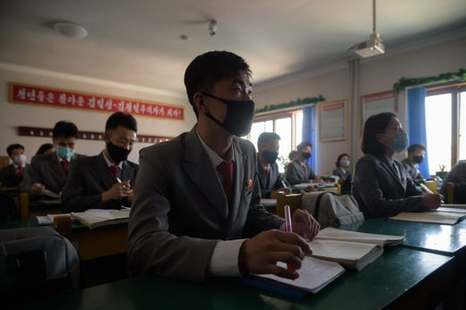 Students wearing face masks attend a lecture on preventative measures against the COVID-19 novel coronavirus at the Pyongyang University of Medicine in Pyongyang on April 22, 2020.