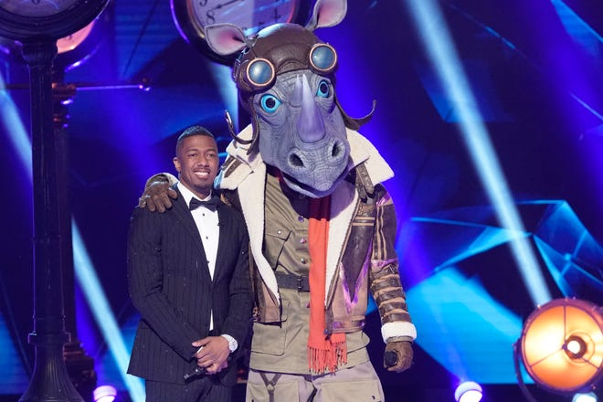 """Host Nick Cannon and the """"Rhino"""" on Fox's """"The Masked Singer,"""" which Fox is hoping to produce in time for September's schedule."""