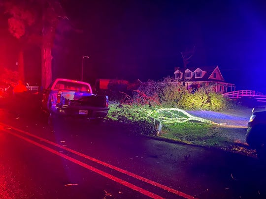 A tree sits in front of a house on Robinson Bridge Road late Wednesday after a storm passed through. Homes in the area were destroyed, and one woman was killed.