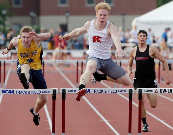Kimberly's Caleb Frazer runs in the Division 1 300 hurdles at the 2019 WIAA state track and field meet.